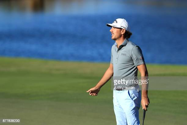 Kelly Kraft of the United States reacts after missing a putt on the 18th green during the final round of The RSM Classic at Sea Island Golf Club...