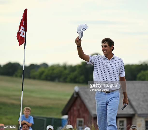 Kelly Kraft waves to the crowd after winning the US Amateur Championship at Erin Hills Golf Course on August 28 2011 in Erin Wisconsin