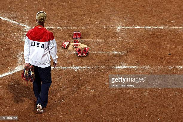 Kelly Kretschman of the United States walks out to leave her spikes at home plate after USA lost 31 to Japan during the women's grand final gold...