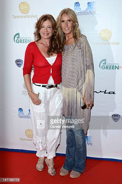 Kelly LeBrock and Tiziana Rocca poses at the photocall of Day 5 during the 58th Taormina Film Fest on June 27 2012 in Taormina Italy
