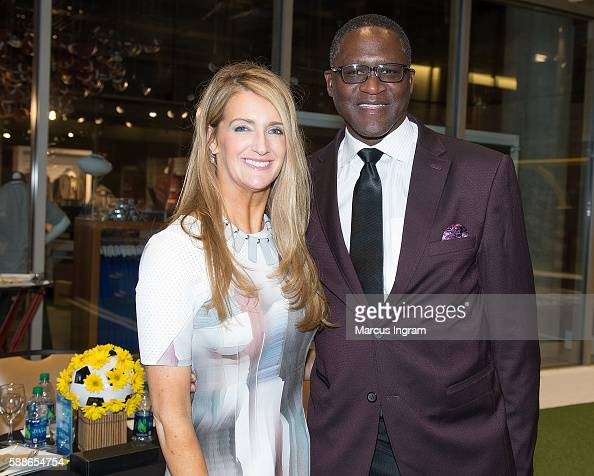 Kelly Loeffler and Dominique Wilkins attend the 2016 S3 Summit/PRO2CEO at College Football Hall of Fame on August 11 2016 in Atlanta Georgia