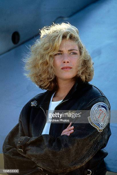 Kelly McGillis folds her arms in a scene from the film 'Top Gun' 1986