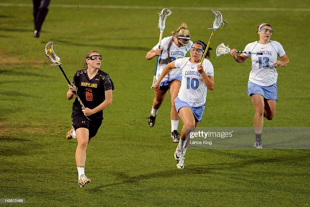 Kelly McPartland #6 of the Maryland Terrapins runs with the ball against the North Carolina Tar Heels during the finals of the 2012 Women's ACC Tournament at Koskinen Stadium on April 23, 2012 in Durham, North Carolina.