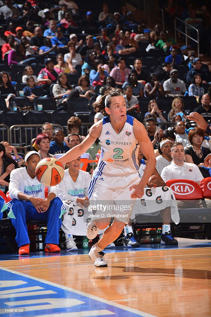 Kelly Miller #2 of the New York Liberty drives against the Connecticut Sun during the game on May 19, 2012 at Madison Square Garden in New York, New York.