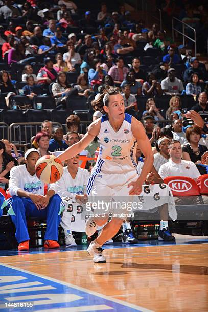 Kelly Miller of the New York Liberty drives against the Connecticut Sun during the game on May 19 2012 at Madison Square Garden in New York New York...