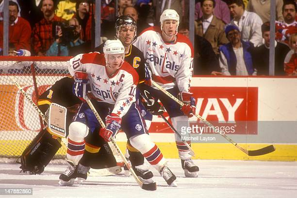 Kelly Miller of the Washington Capitals looks for a pass during a hockey game against the Vancouver Canucks on January 5 1990 at the USAir Arena in...