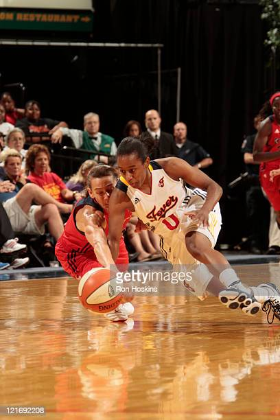 Kelly Miller of the Washington Mystics battles Shannon Bobbitt of the Indiana Fever at Conseco Fieldhouse on August 21 2011 in Indianapolis Indiana...