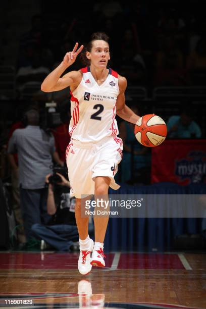 Kelly Miller of the Washington Mystics dribbles against the Chicago Sky at the Verizon Center on June 11 2011 in Washington DC NOTE TO USER User...