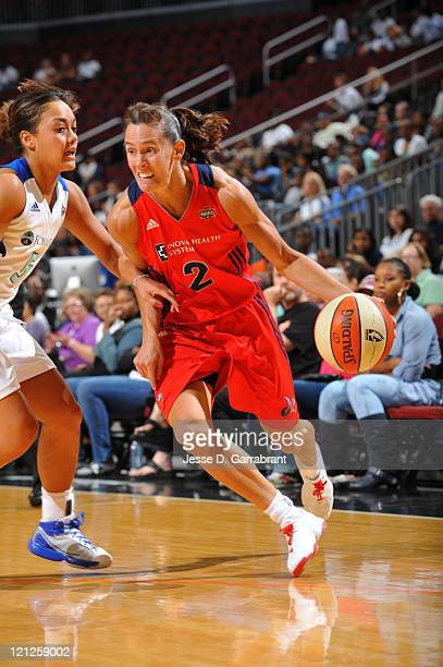 Kelly Miller of the Washington Mystics drives against the New York Liberty during a game on August 16 2011 at the Prudential Center in Newark New...