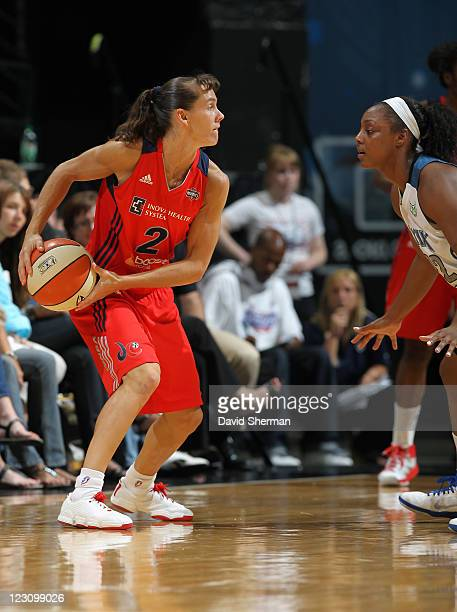 Kelly Miller of the Washington Mystics looks for the pass against Monica Wright of the Minnesota Lynx during the game on August 30 2011 at Target...
