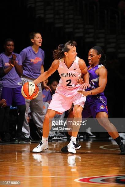 Kelly Miller of the Washington Mystics moves the ball against the Phoenix Mercury at the Verizon Center on August 28 2011 in Washington DC NOTE TO...
