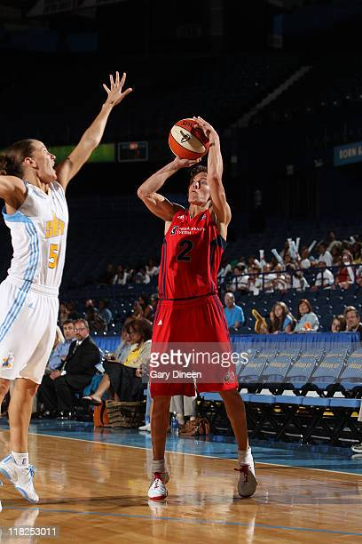 Kelly Miller of the Washington Mystics takes aim over Erin Thorn of the Chicago Sky during the WNBA game on July 5 2011 at the AllState Arena in...