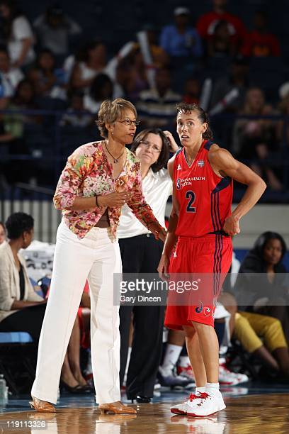 Kelly Miller of the Washington Mystics talks to head coach Trudi Lacey of the Washington Mystics against the Chicago Sky during the WNBA game on July...
