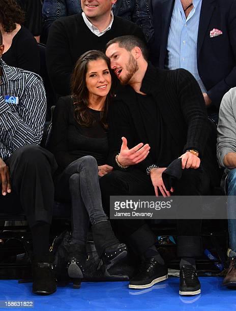 Kelly Monaco and Valentin Chmerkovskiy attend the Chicago Bulls vs New York Knicks game at Madison Square Garden on December 21 2012 in New York City