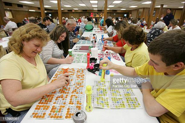 Kelly Nolan left her son Brian Nolan right and several other relatives play bingo May 18 at the American Legion Post 370 in Overland Park Kansas At...