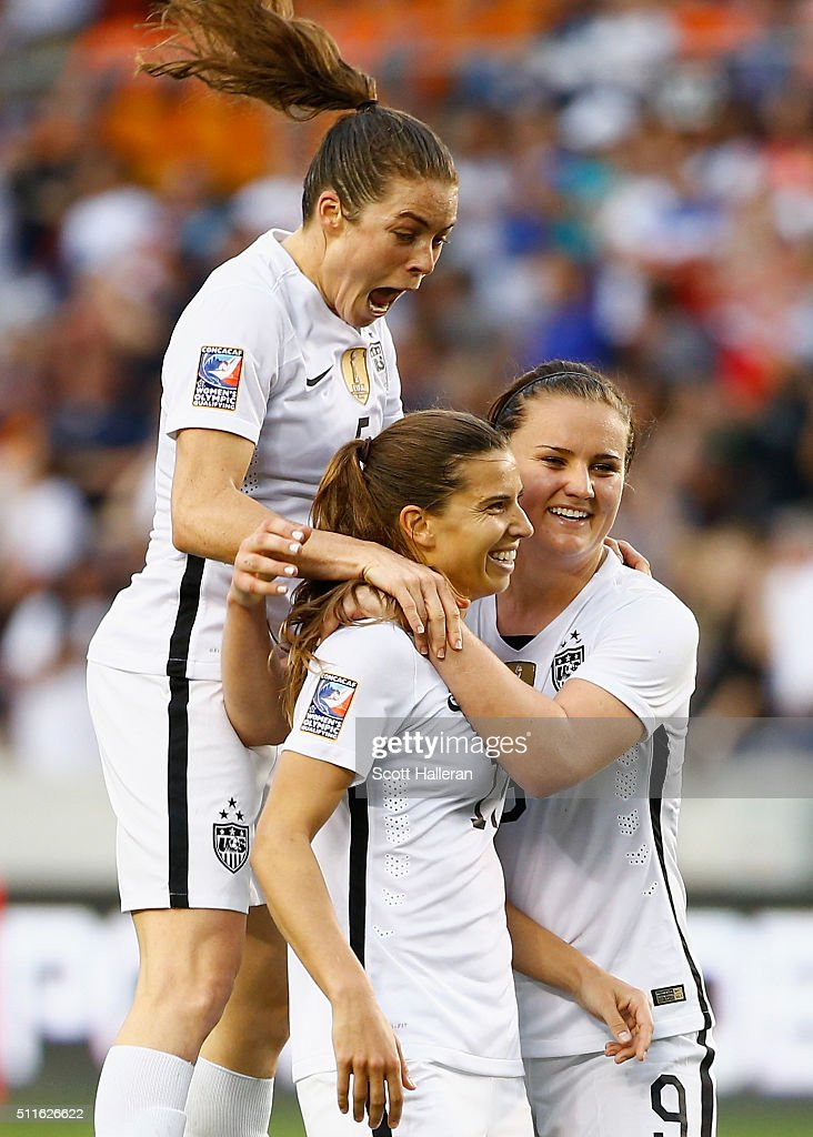Kelly O'Hara #5, Lindsey Horan #9 and Tobin Heath #17 of the United States celebrate after Heath scored a second half goal against Canada during the Championship final of the 2016 CONCACAF Women's Olympic Qualifying at BBVA Compass Stadium on February 21, 2016 in Houston, Texas.
