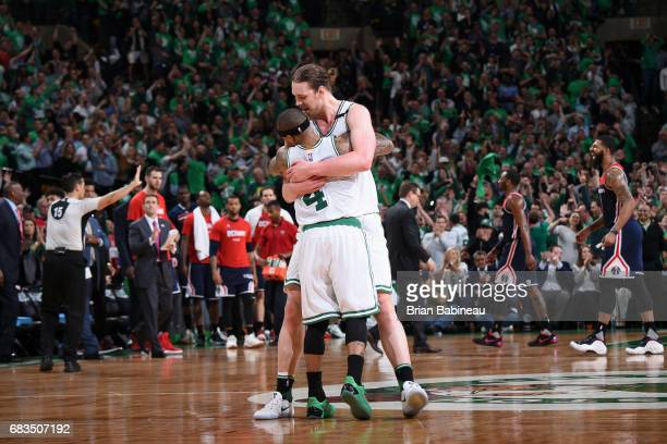 Kelly Olynyk and Isaiah Thomas of the Boston Celtics hug during the game against the Washington Wizards during Game Seven of the Eastern Conference...