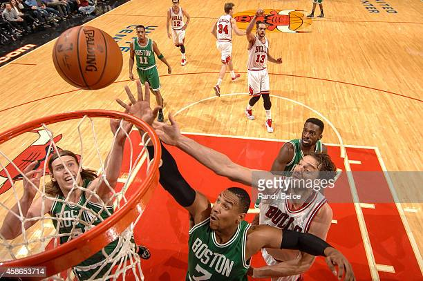 Kelly Olynyk and Jared Sullinger of the Boston Celtics go up for the rebound against Pau Gasol of the Chicago Bulls on November 08 2014 at the United...