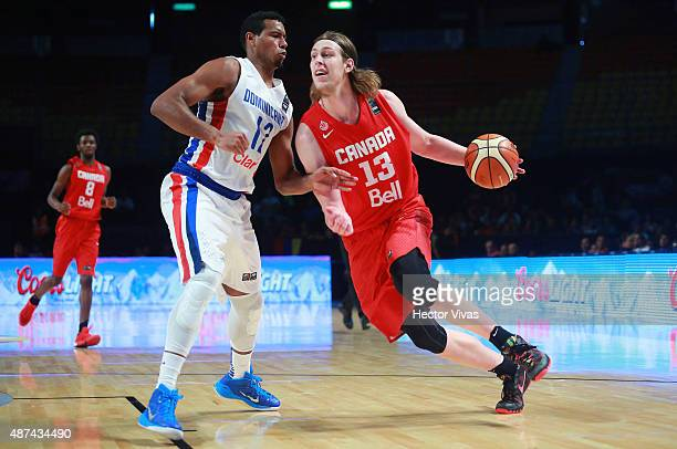 Kelly Olynyk of Canada dribbles the ball against Orlando Sanchez of Dominican Republic during a second stage match between Dominican Republic and...