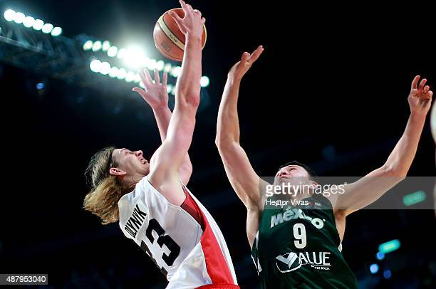 Kelly Olynyk of Canada handles the ball against Francisco Cruz of Mexico during a third place match between Canada and Mexico as part of the 2015...
