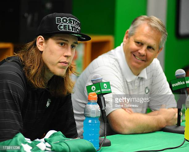 Kelly Olynyk of the Boston Celtics and General Manager Danny Ainge speak to the media at the introductory press conference for the Boston Celtics'...