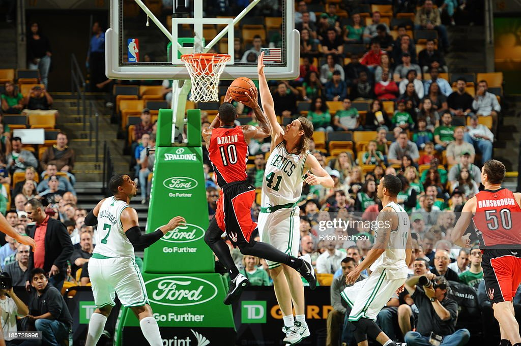 Kelly Olynyk #41 of the Boston Celtics attempts a block a shot against DeMar DeRozan #10 of the Toronto Raptors on October 7, 2013 at the TD Garden in Boston, Massachusetts.