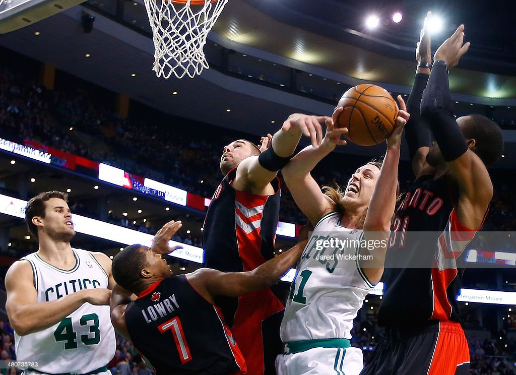 <a gi-track='captionPersonalityLinkClicked' href=/galleries/search?phrase=Kelly+Olynyk&family=editorial&specificpeople=5953512 ng-click='$event.stopPropagation()'>Kelly Olynyk</a> #41 of the Boston Celtics attempts to grab a loose rebound in front of <a gi-track='captionPersonalityLinkClicked' href=/galleries/search?phrase=Terrence+Ross&family=editorial&specificpeople=6781663 ng-click='$event.stopPropagation()'>Terrence Ross</a> #31 and <a gi-track='captionPersonalityLinkClicked' href=/galleries/search?phrase=Kyle+Lowry&family=editorial&specificpeople=714625 ng-click='$event.stopPropagation()'>Kyle Lowry</a> #7 of the Toronto Raptors in the second half during the game at TD Garden on March 26, 2014 in Boston, Massachusetts.
