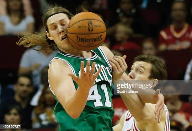 Kelly Olynyk of the Boston Celtics battles for a loose ball with Omer Asik of the Houston Rockets at the Toyota Center on November 19 2013 in Houston...