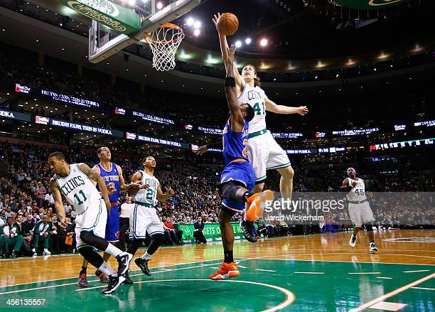 Kelly Olynyk of the Boston Celtics blocks the shot of Iman Shumpert of the New York Knicks in the fourth quarter during the game at TD Garden on...