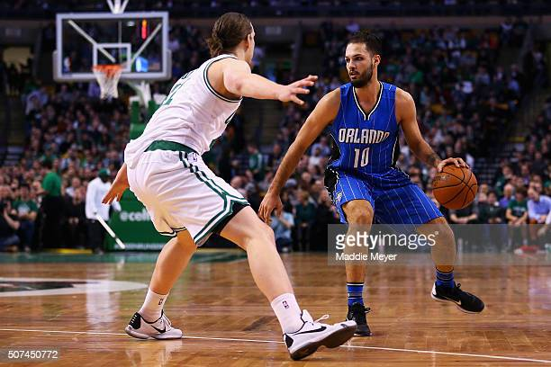 Kelly Olynyk of the Boston Celtics defends Evan Fournier of the Orlando Magic during the second quarter at TD Garden on January 29 2016 in Boston...