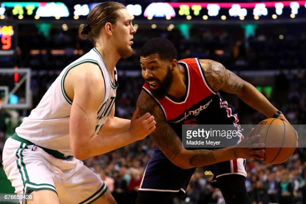 Kelly Olynyk of the Boston Celtics defends Markieff Morris of the Washington Wizards during the first quarter of Game Two of the Eastern Conference...