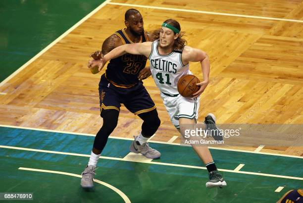Kelly Olynyk of the Boston Celtics dribbles the ball against LeBron James of the Cleveland Cavaliers in the first half during Game Five of the 2017...