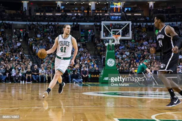 Kelly Olynyk of the Boston Celtics dribbles the ball against the Brooklyn Nets on April 10 2017 at the TD Garden in Boston Massachusetts NOTE TO USER...
