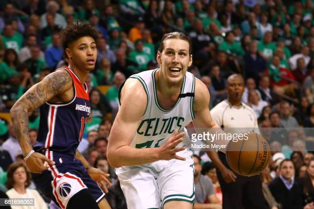 Kelly Olynyk of the Boston Celtics drives against Kelly Oubre Jr #12 of the Washington Wizards during the second half of Game Five of the Eastern...
