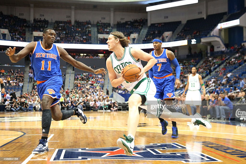 Kelly Olynyk of the Boston Celtics drives against Samuel Dalembert of the New York Knicks during a preseason game at the XL Center on October 8 2014...