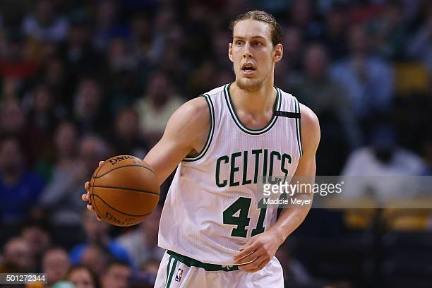 Kelly Olynyk of the Boston Celtics drives against the Golden State Warriors during the second quarter at TD Garden on December 11 2015 in Boston...