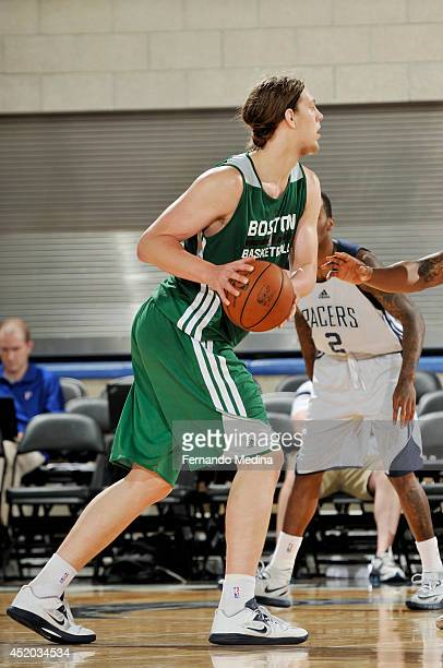 Kelly Olynyk of the Boston Celtics drives against the Indiana Pacers during the Samsung NBA Summer League 2014 on July 11 2014 at Amway Center in...
