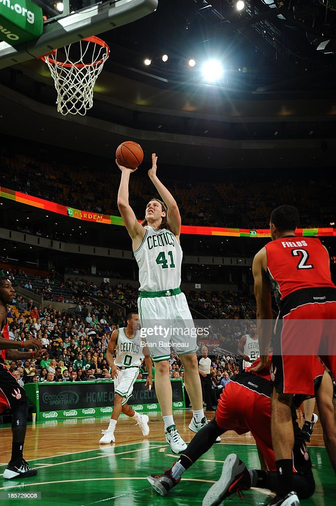 Kelly Olynyk #41 of the Boston Celtics drives to the basket against the Toronto Raptors on October 7, 2013 at the TD Garden in Boston, Massachusetts.