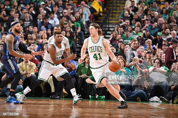 Kelly Olynyk of the Boston Celtics drives to the basket against the Dallas Mavericks during the game on November 18 2015 at TD Garden in Boston...