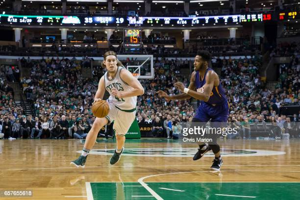 Kelly Olynyk of the Boston Celtics drives to the basket against the Phoenix Suns on March 24 2017 at TD Garden in Boston Massachusetts NOTE TO USER...
