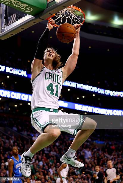 Kelly Olynyk of the Boston Celtics dunks against the Orlando Magic during a game at the TD Garden on November 11 2013 in Boston Massachusetts NOTE TO...