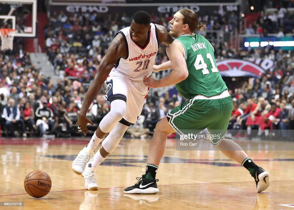 Kelly Olynyk #41 of the Boston Celtics fouls Ian Mahinmi #28 of the Washington Wizards during Game Six of the NBA Eastern Conference Semi-Finals at Verizon Center on May 12, 2017 in Washington, DC.
