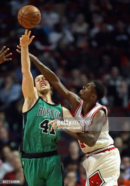 Kelly Olynyk of the Boston Celtics gets off a pass under presure from Bobby Portis of the Chicago Bulls at the United Center on February 16 2017 in...