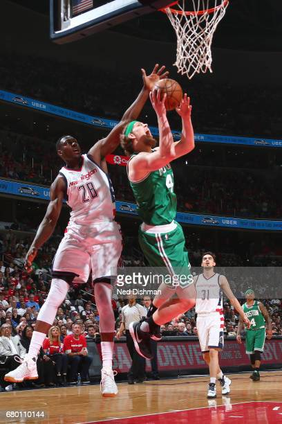 Kelly Olynyk of the Boston Celtics goes to the basket against the Washington Wizards in Game Four of the Eastern Conference Semifinals of the 2017...