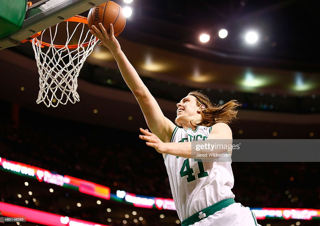 Kelly Olynyk #41 of the Boston Celtics goes up for a layup against the Washington Wizards in the second quarter during the game at TD Garden on April 16, 2014 in Boston, Massachusetts.