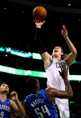 Kelly Olynyk of the Boston Celtics goes up for a shot as Jason Maxiell of the Orlando Magic defends during a game at the TD Garden on November 11...