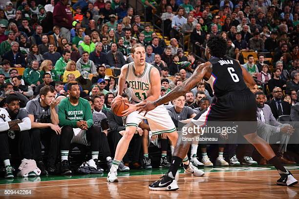 Kelly Olynyk of the Boston Celtics handles the ball against DeAndre Jordan of the Los Angeles Clippers on February 10 2016 at the TD Garden in Boston...