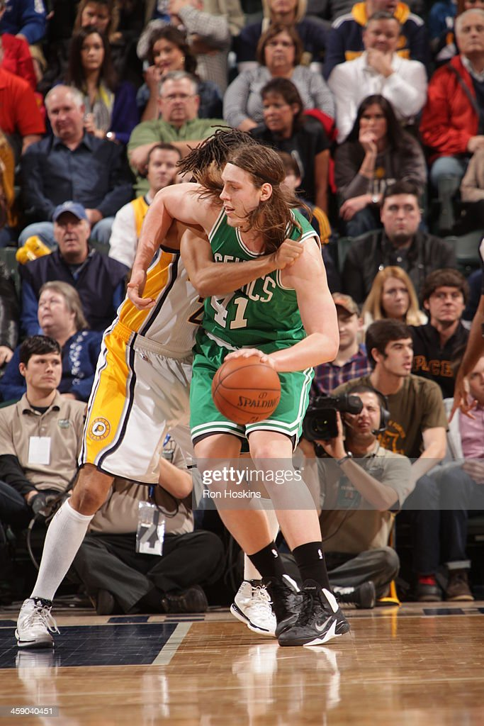 Kelly Olynyk #41 of the Boston Celtics handles the ball against the Indiana Pacers on December 22, 2013 in Indianapolis, Indiana at Bankers Life Fieldhouse.
