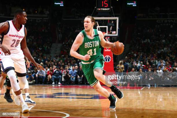 Kelly Olynyk of the Boston Celtics handles the ball during the game against the Washington Wizards during Game Six of the Eastern Conference...