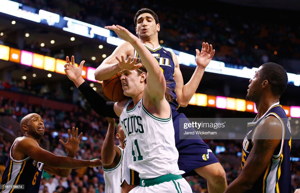 <a gi-track='captionPersonalityLinkClicked' href=/galleries/search?phrase=Kelly+Olynyk&family=editorial&specificpeople=5953512 ng-click='$event.stopPropagation()'>Kelly Olynyk</a> #41 of the Boston Celtics is fouled by <a gi-track='captionPersonalityLinkClicked' href=/galleries/search?phrase=Enes+Kanter&family=editorial&specificpeople=5621416 ng-click='$event.stopPropagation()'>Enes Kanter</a> #0 of the Utah Jazz in the second half against the Utah Jazz at TD Garden on November 6, 2013 in Boston, Massachusetts.